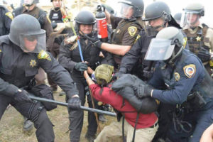 female-protester-being-violently-assaulted-by-multiple-law-enforcement-personnel