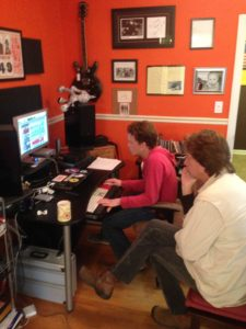 "Bob Britt and engineer Chad Brown going through mixes for ""Little Folks Like You & Me"""